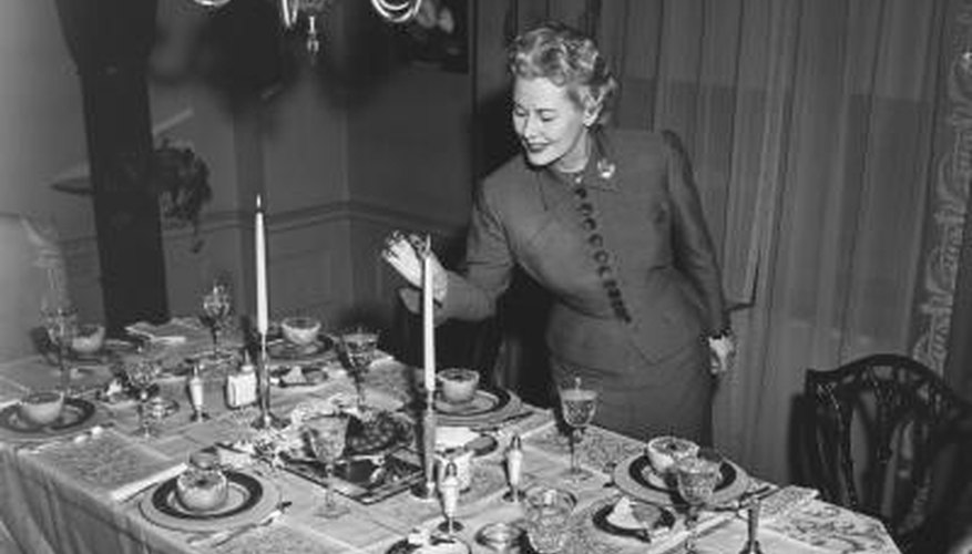 A 1930s dining room was decorated with modern plateware and silver-plated candles.
