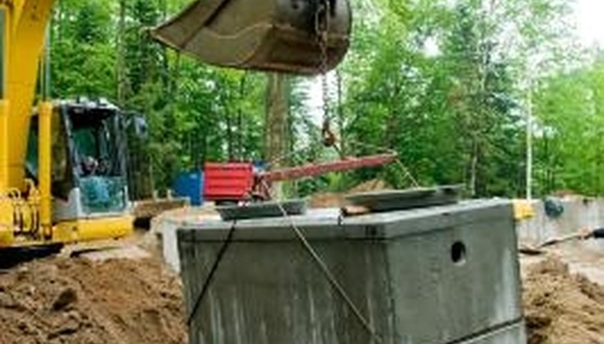 Access to buried septic tanks is accomplished through risers.