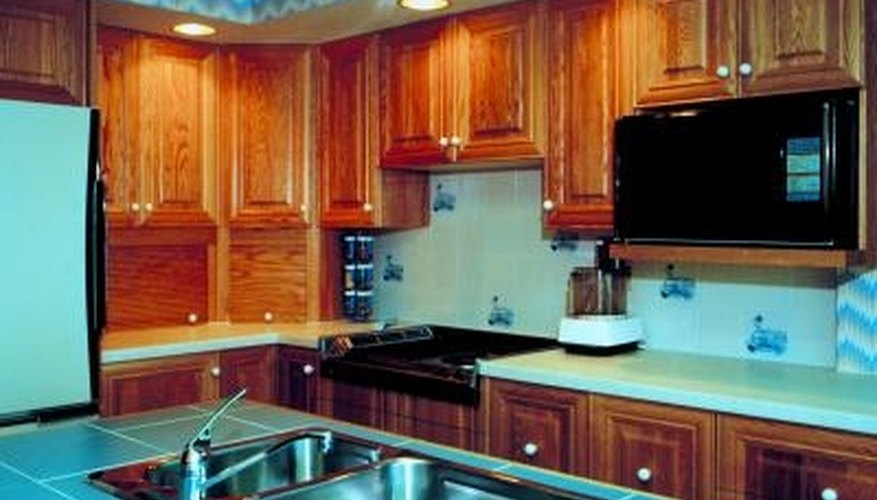 Update the look and feel of your kitchen by redoing old wooden cabinets.