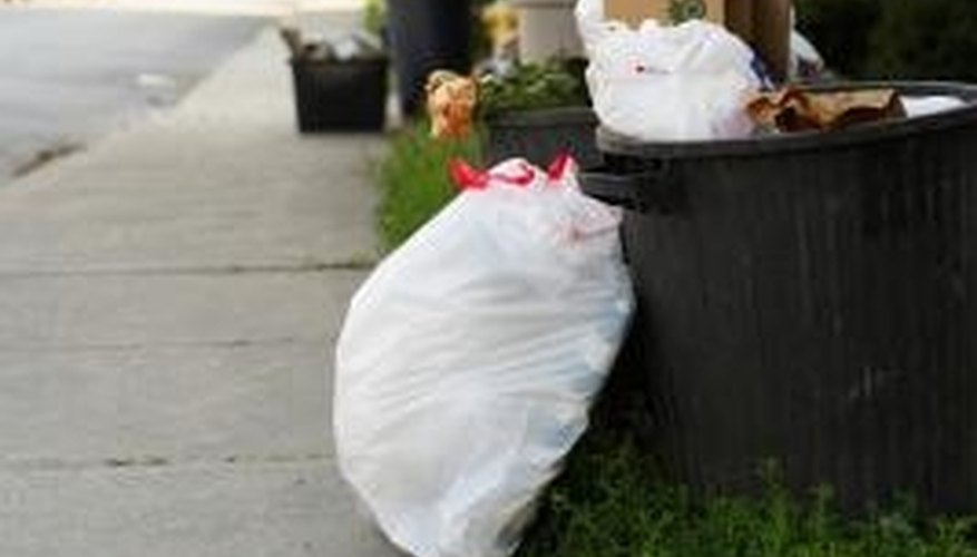 Garbage compactors may help reduce the size of garbage but also present some problems.