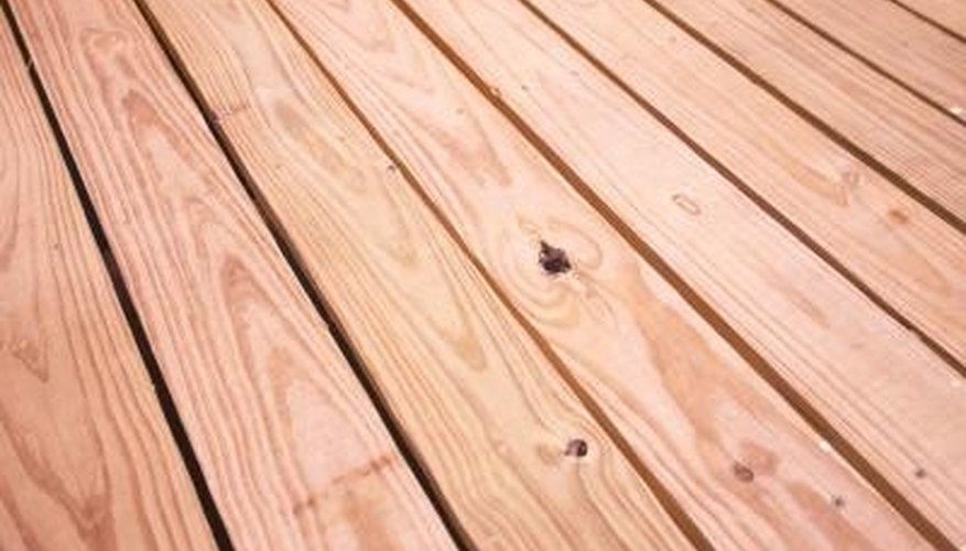 Tiles conceal blemishes on wood decks.