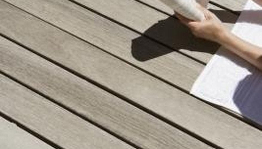 Stain a deck and protect it with a waterproof sealant.