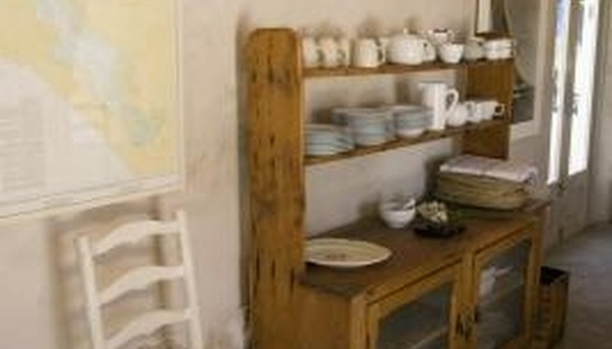 A primitive cabinet is ideal for displaying collectibles.