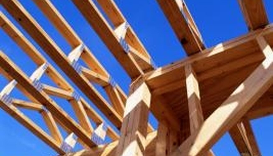 Rafters and trusses rest on top of wall plates and connect to wall framing by direct nailing and metal straps.