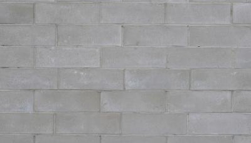 Stucco adheres to cinder block well, since it is made of similar material.