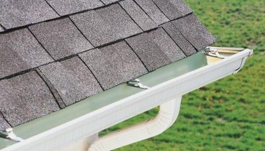 Hang shingles over the edge of the roof by an inch to aid in shedding water.