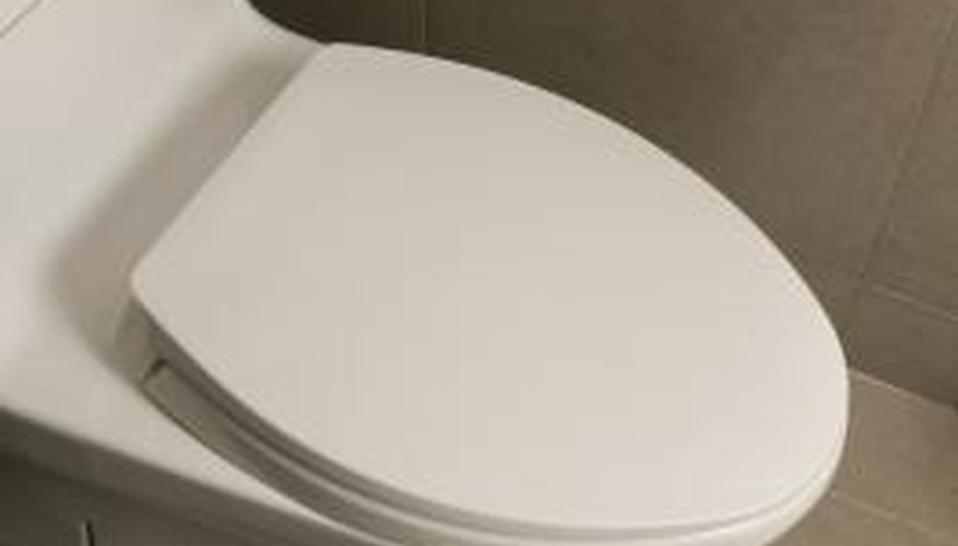 Make sure the wax ring is situated between the drain flange and toilet base.