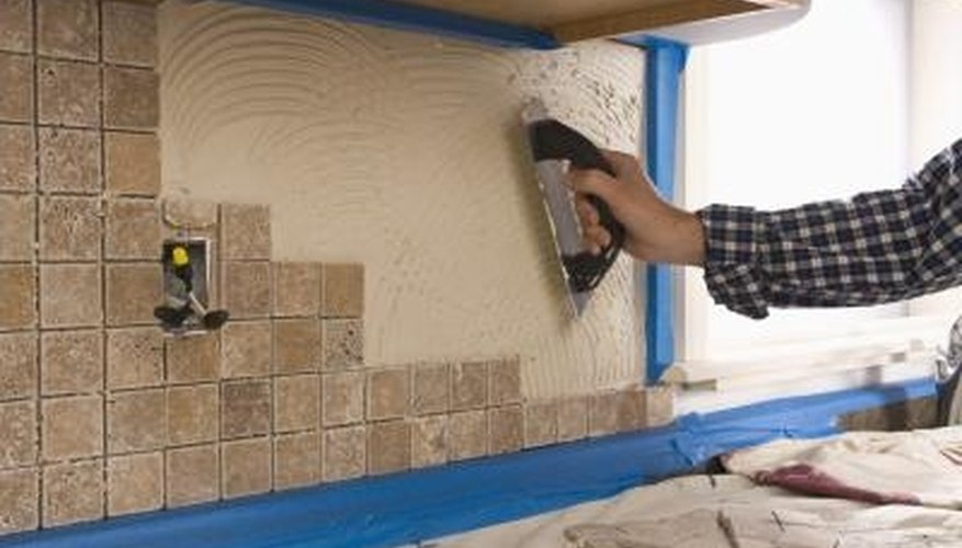 Tile protects kitchen walls from moisture and grease.