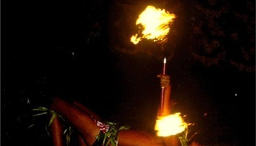 Samoan men perform dances with a fire knife.