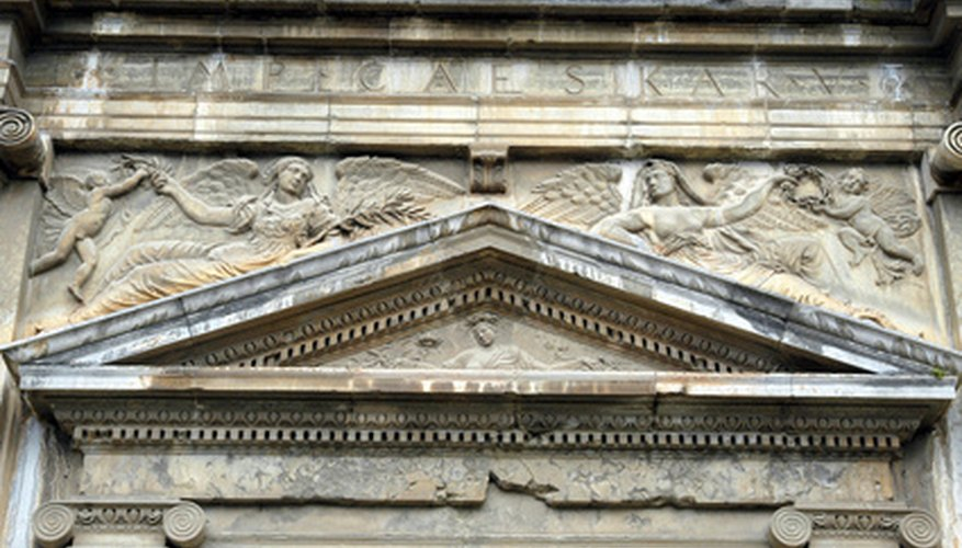 A pediment adorns a building's main entry.