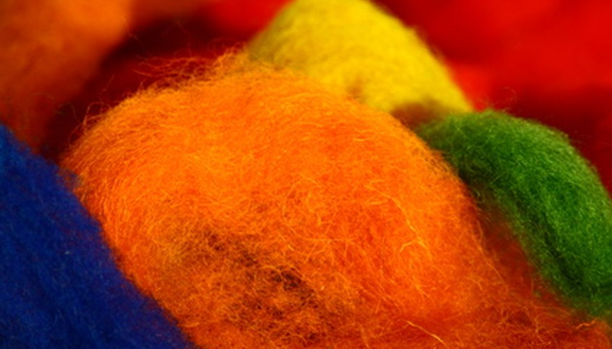 Raw wool is typically grey or black, but can be dyed before the felting process to create colorful patterns.