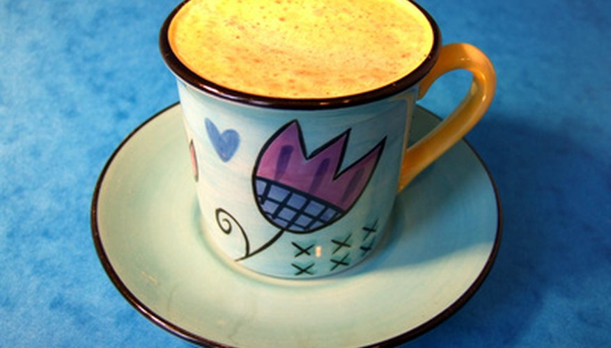 Painting your own coffee cups is a creative project with useful results.