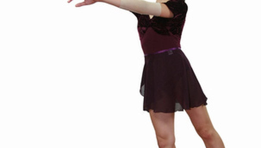 A young dancer in third arabesque tendu