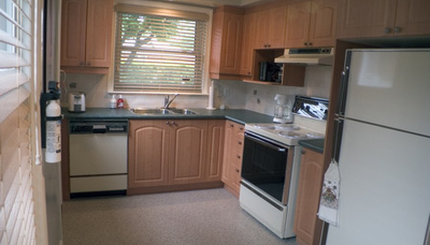 Kitchen cabinets could be laminate or natural wood.