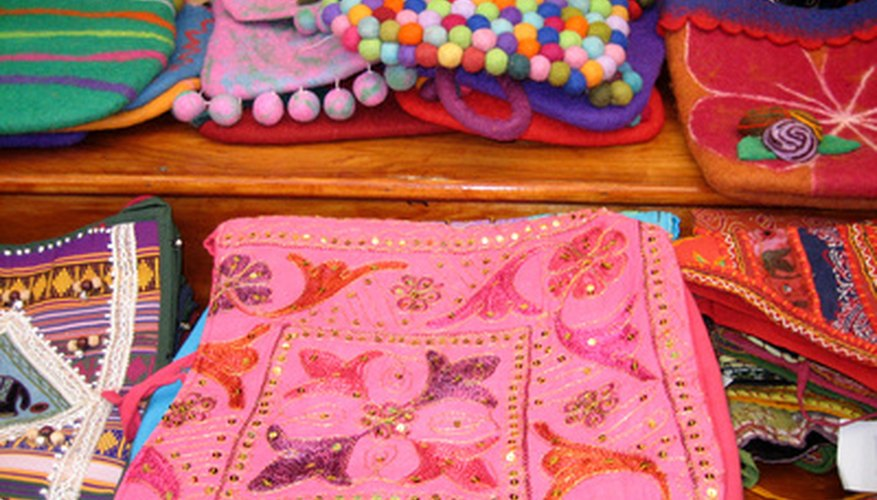Handmade purses are an option of what to sell at a flea market.