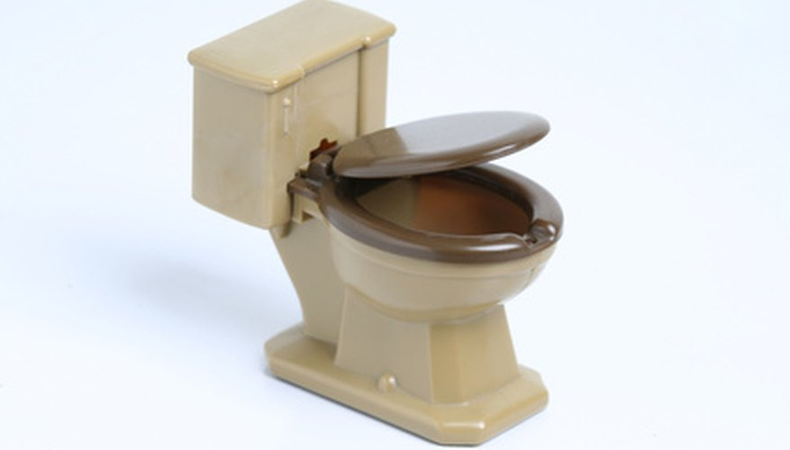 A hissing sound may be a sign your toilet stopper needs replacing.