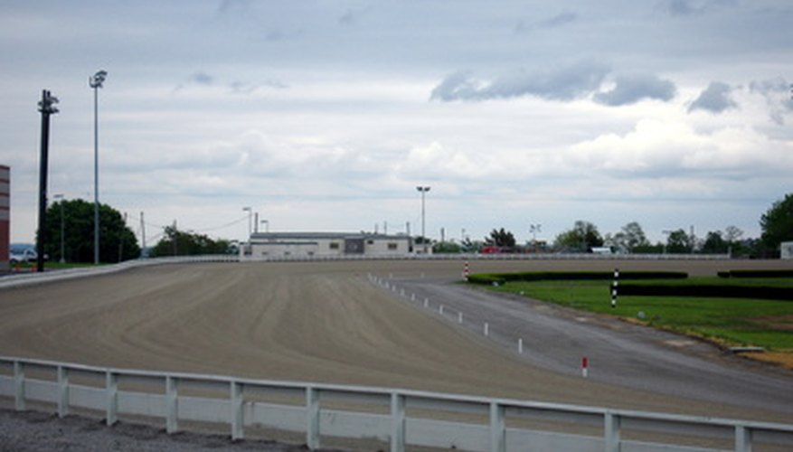 The inward slant of a racetrack is an applied use of centrifugal force.