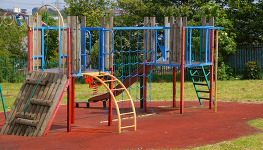 A play set in a yard will provide hours of amusement for children.