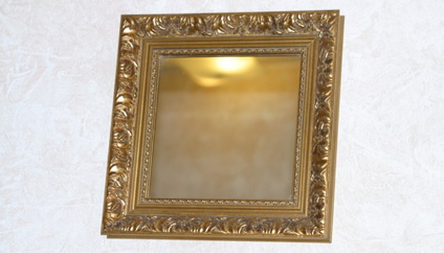 Gilded frames give your mirror an antique look.