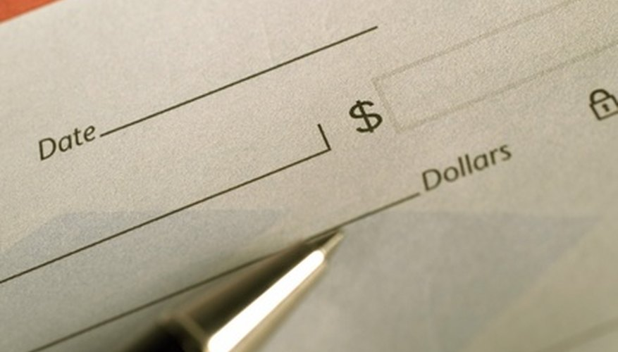 You can order checks through the bank or an outside vendor.