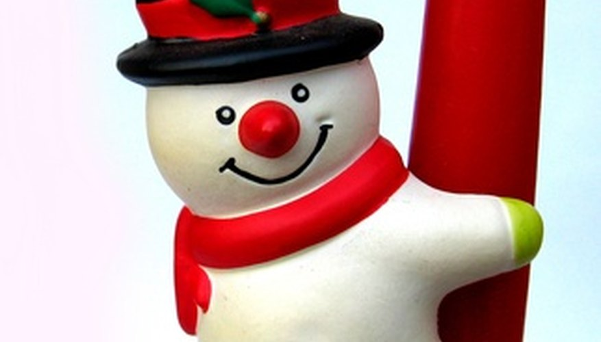 Make a snowman's top hat out of newspaper and black spray paint.