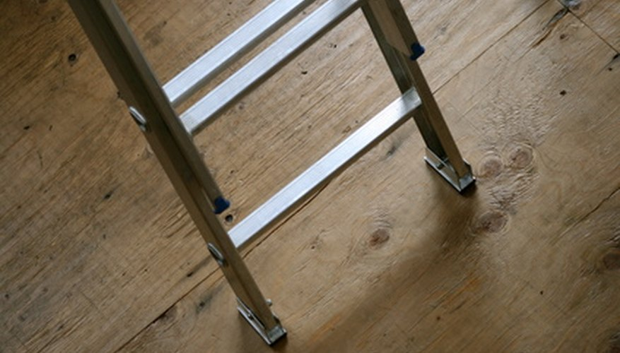 Place an extension ladder's feet flat on the ground.