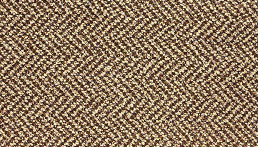 The herringbone pattern is a twill weave offset in a mirror image every few rows.