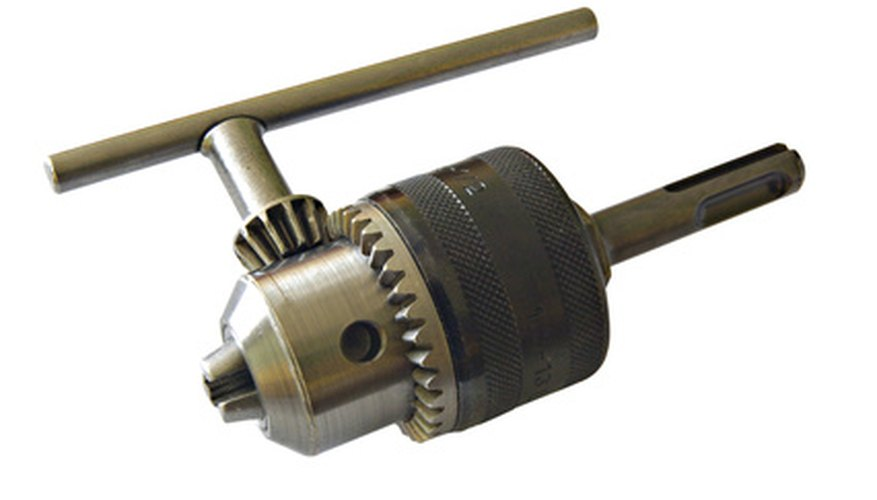 A removed drill chuck with the chuck key inserted