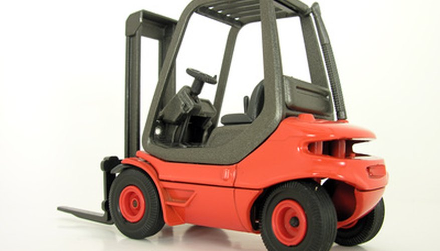 A forklift facilitates material handling on the shop floor.