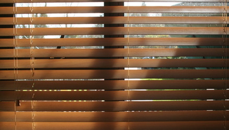 The string running through these blinds is part of a pulley system.