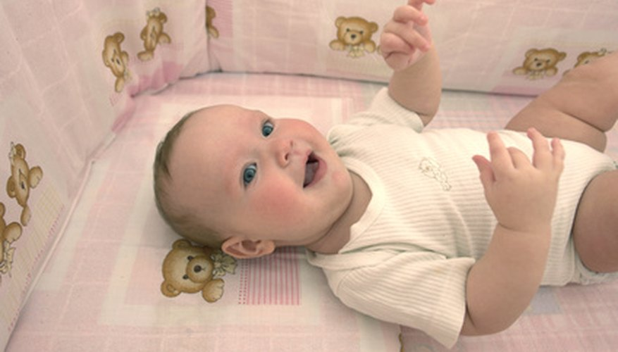 Cot bumpers protect babies from harming themselves on crib slats.