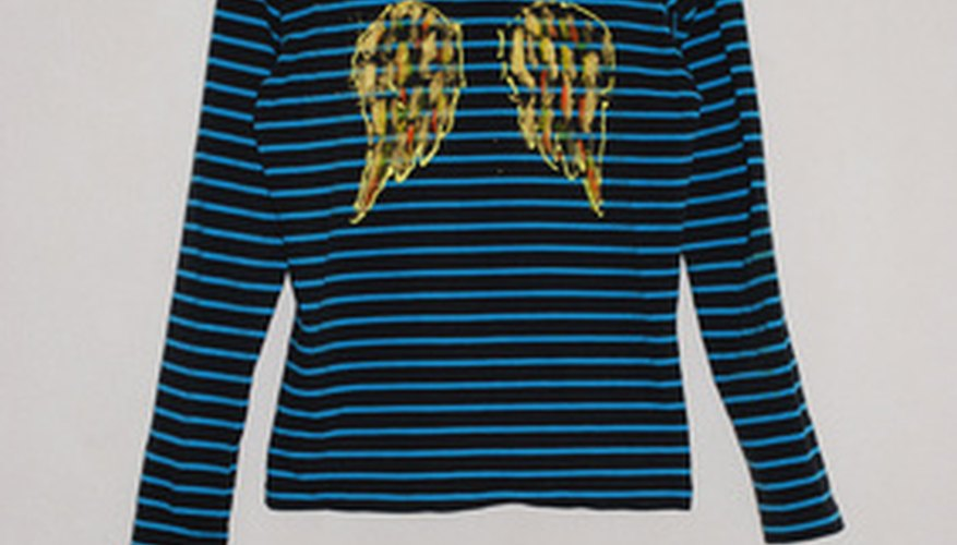 Add some angel wings to a plain shirt with a transfer pencil and fabric paint.