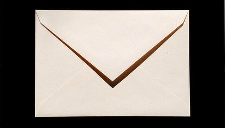 Use recyled paper to make your own envelopes.
