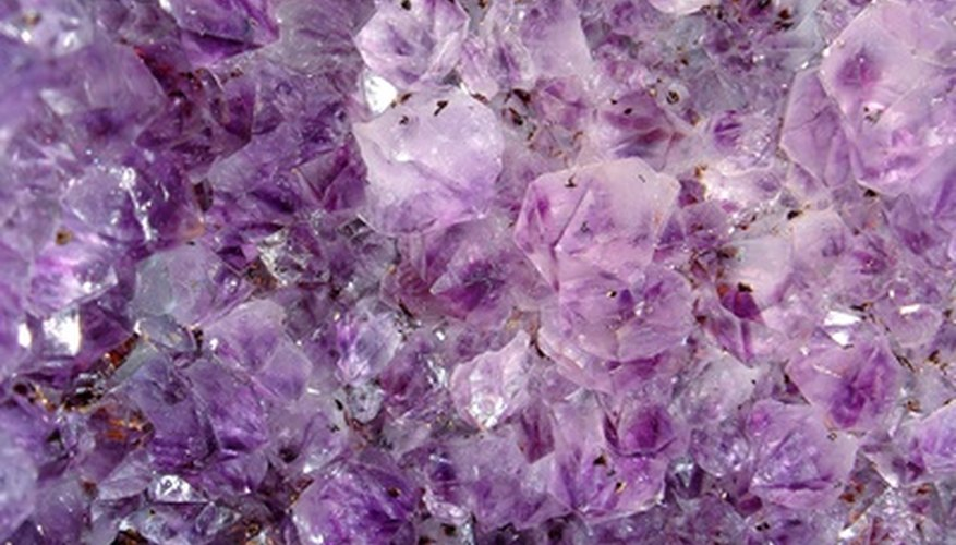 What causes some clear glass to turn purple?  Hint: It's not magic.