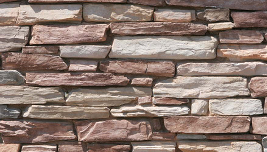 Stone walls use adhesive to bond.