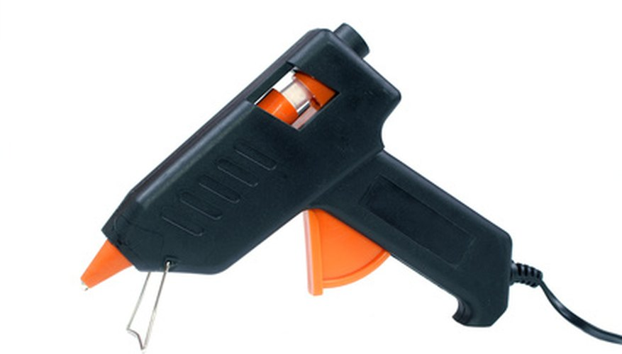 Hot glue guns can melt plastic sheeting.