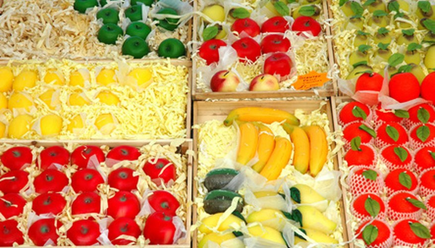 Plastic or wax fruit peices are easy to find at local craft stores.