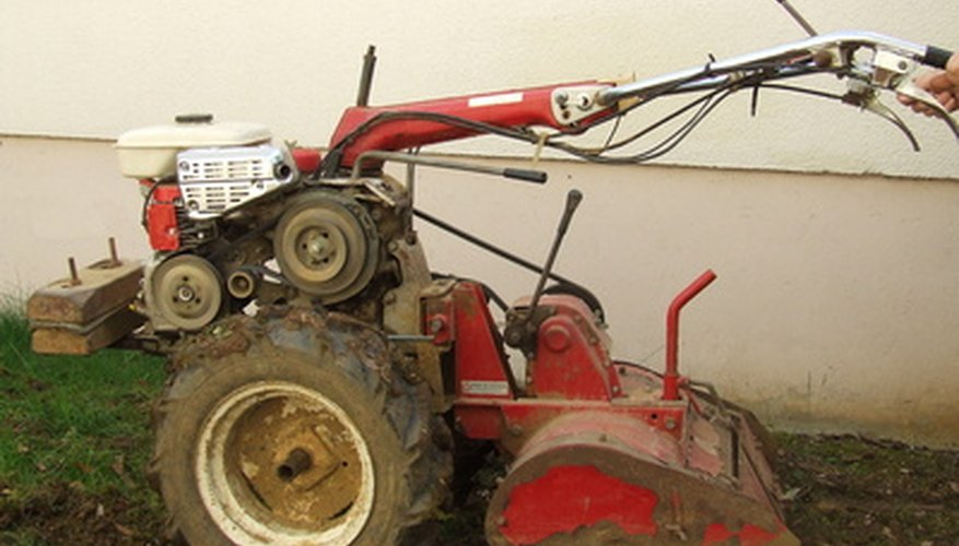 Motorized rotary tillers dig deep within the soil.