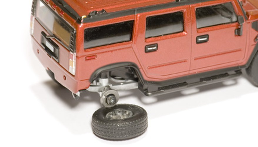 Be careful when removing the wheels of a die-cast model car.