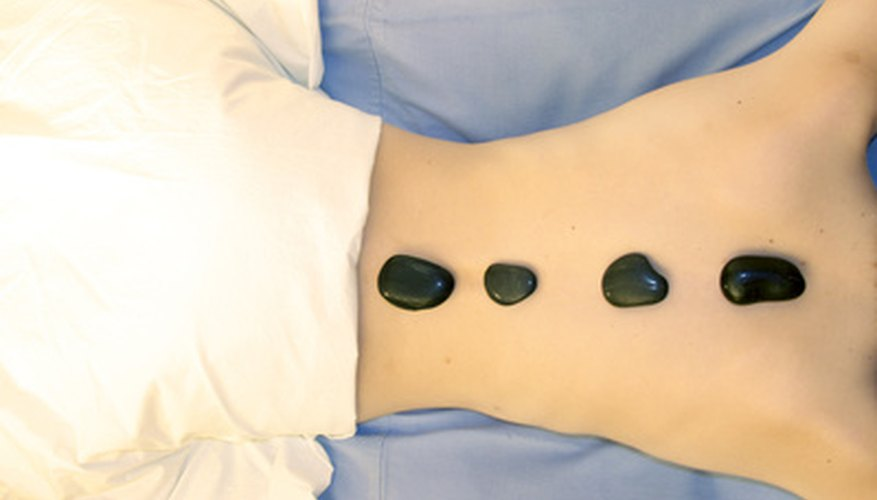 Hot stone massage of other areas of the body can help prepare a woman for yoni massage.