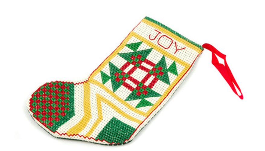 Needlepoint letters add the perfect touch to this Christmas stocking.