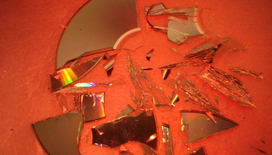 Broken CD pieces make an interesting tabletop mosaic.