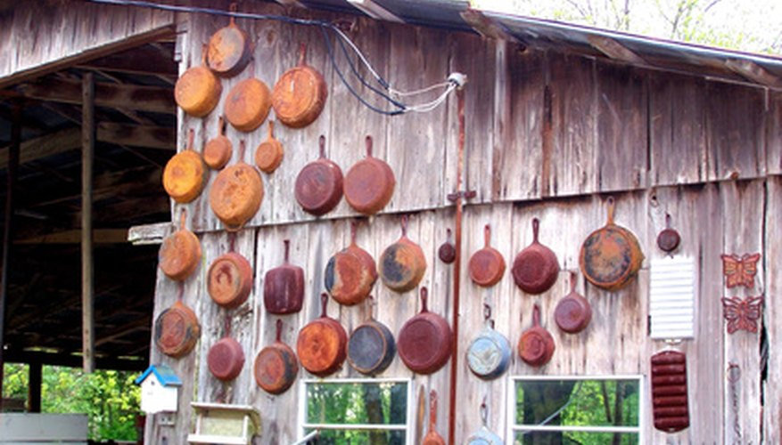 Cast-iron pans on the wall of a shed