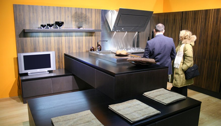 Wooden countertops can be cut into desired sises with a table saw.