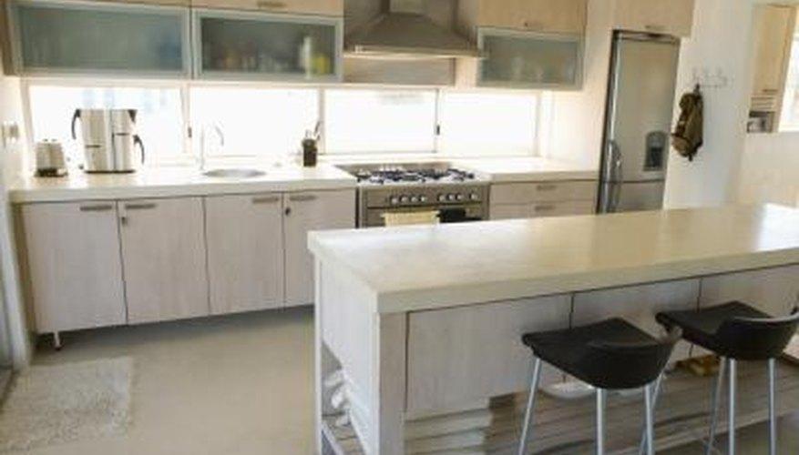 Upper cabinets often open upward on modern kitchens.