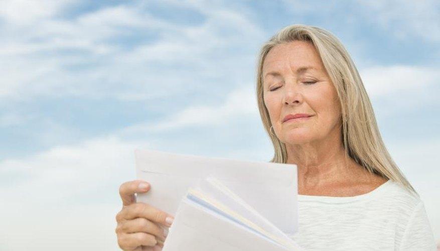 Senior woman reading mail
