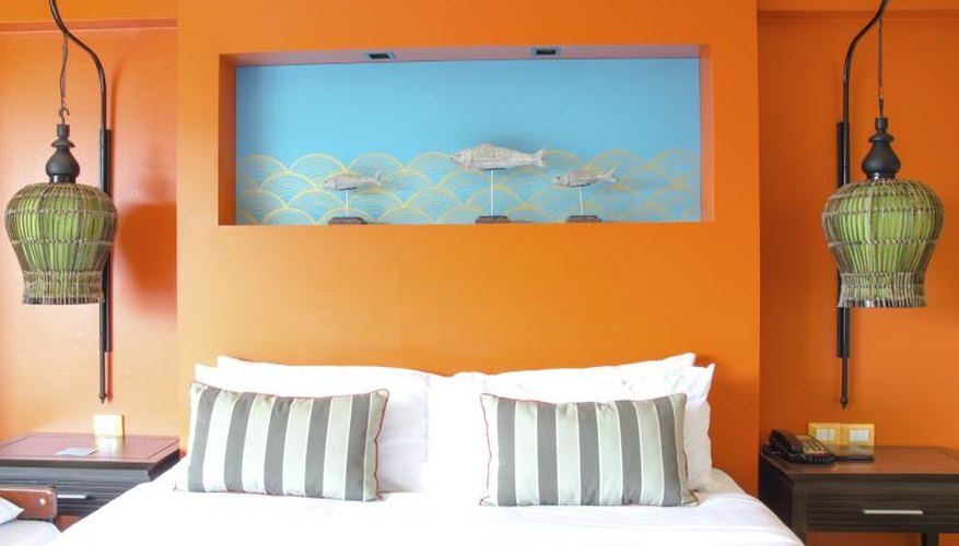 Modern master bedroom with orange and blue accents