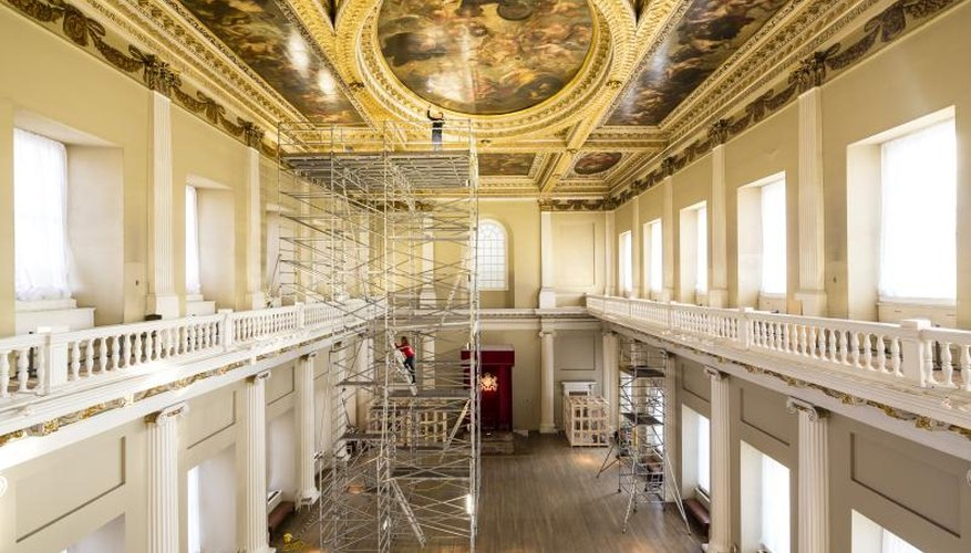 The restoration of a painted ceiling in a historic building.