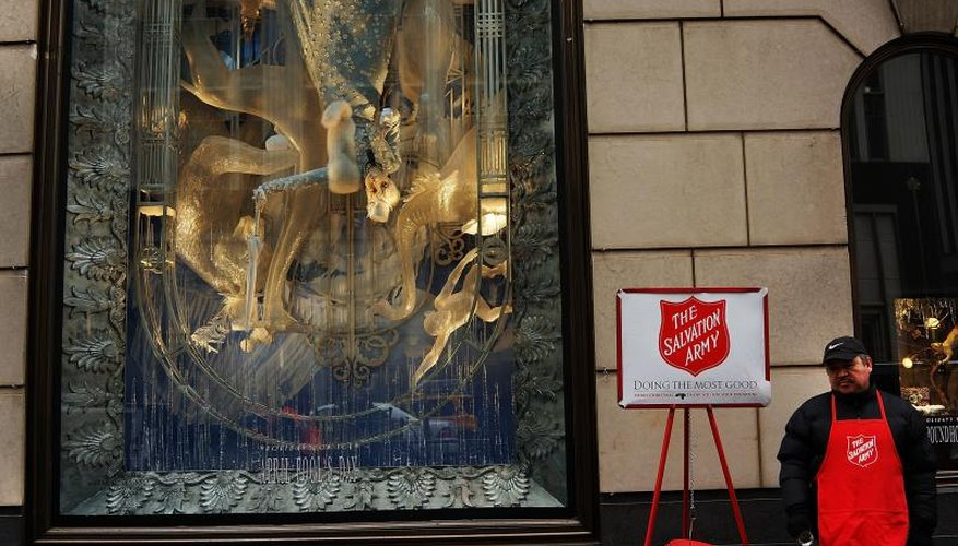 Salvation Army worker asks for donations.
