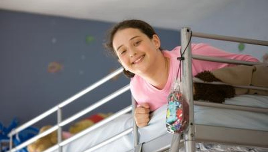 A rope ladder helps children climb into top bunk beds.